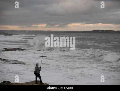Fishing off off of Beavertail lighthouse in Jamestown Rhode Island - Stock Photo