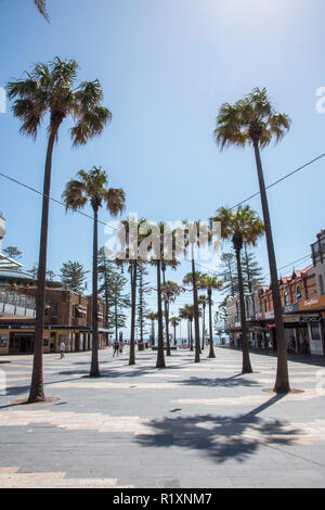 Manly, New South Wales,Australia-December 21,2016: Outdoor shopping mall with tourists and Manly Beach view in Manly, Australia - Stock Photo