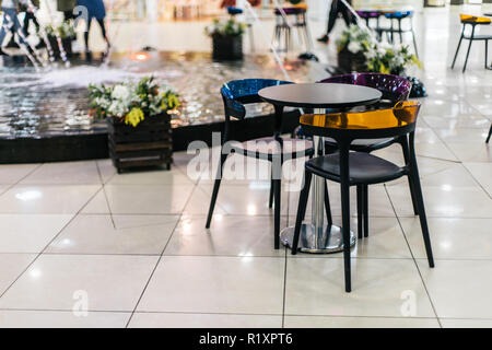 Colorful table and chairs as a part of mall interior - Stock Photo