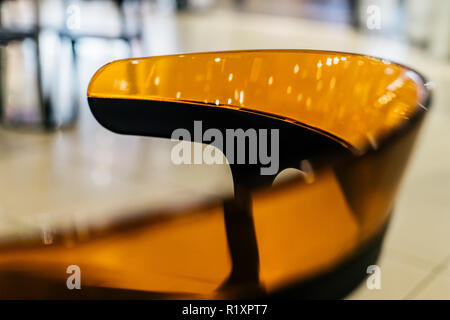 Colorful chair close up with plastic transparent body - Stock Photo