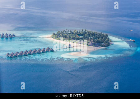 Aerial view of Maldives atolls is the world top beauty. Maldives tourism. - Stock Photo