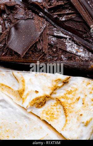 background of whipped cream and black chocolate delicious cakes close up - Stock Photo