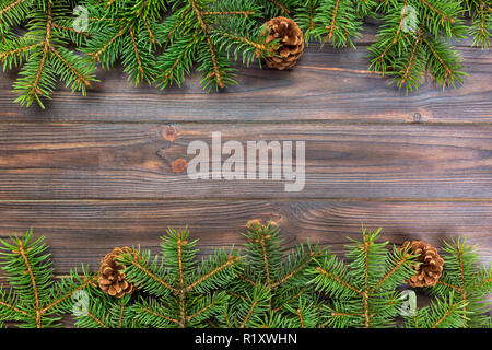 Christmas gray wooden background with fir tree frame and cones copy space. top view empty space for your design. - Stock Photo