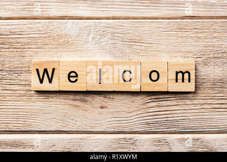 welcom word written on wood block. welcom text on table, concept. - Stock Photo