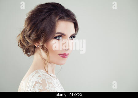 Beautiful female face. Young perfect woman with makeup and bridal hairdo, portrait - Stock Photo
