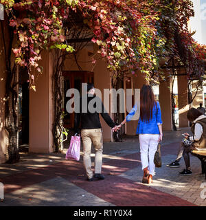 Couple holding hands walking through the mall Fremantle - Stock Photo