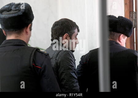 Moscow, Russia. 15th Nov, 2018. MOSCOW REGION, RUSSIA - NOVEMBER 15, 2018: Serpukhov resident Dmitry Grachev (C) who chopped off his wife's hands with an axe out of jealousy, is escorted by police officers after the announcement of the verdict at the Serpukhov Court. The Russian Court sentences Grachev to 14 years in high-security prison colony. Maxim Grigoryev/TASS Credit: ITAR-TASS News Agency/Alamy Live News - Stock Photo