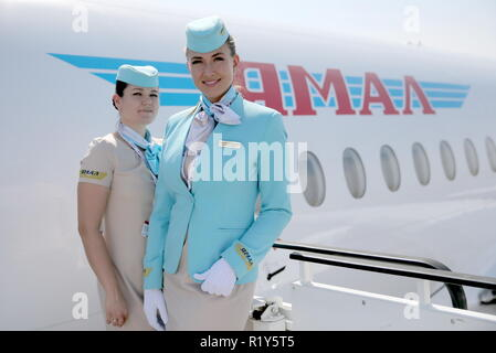 Bahrain. 15th Nov, 2018. BAHRAIN - NOVEMBER 15, 2018: Flight attendants of a Sukhoi Superjet 100 aircraft (SSJ100) of the Yamal Airlines at the 2018 Bahrain International Air Show at the Sakhir air base in Bahrain. 33 military delegations from 19 countries and 20 civilian ones from 35 countries take part in the show. Sergei Savostyanov/TASS Credit: ITAR-TASS News Agency/Alamy Live News - Stock Photo