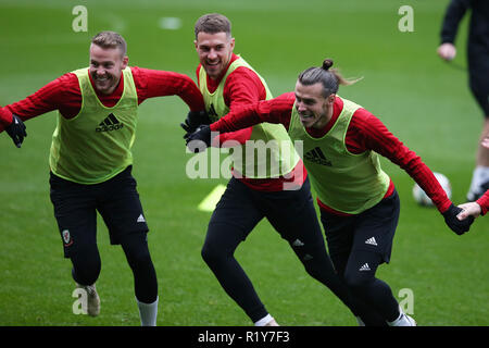 Cardiff, Wales, UK. 15th Nov 2018. Chris Gunter (l), Aaron Ramsey © and Gareth Bale of Wales have fun during the  Wales football squad training at the Cardiff City Stadium in  Cardiff , South Wales on Thursday 15th November 2018.  the team are preparing for their UEFA Nations League match against Denmark tomorrow.   pic by Andrew Orchard/Alamy Live News - Stock Photo