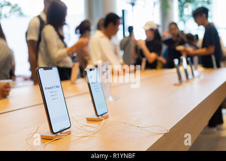 BANGKOK, THAILAND - November 11, 2018:   New iPhone XS Max charging in docking station goes on sale in Apple Store at Iconsiam Bangkok Thailand. - Stock Photo