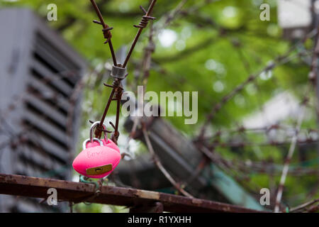 Heart shaped lock on rusted barbed wire at Seoul Tower - Stock Photo