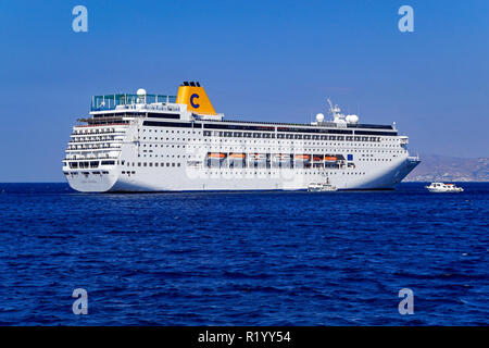 Costa lines cruise ship Costa Riviera at anchor outside Mykonos town on island Mykonos in the Cyclades group in the Aegean Sea Greece - Stock Photo