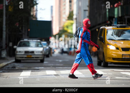 NEW YORK CITY - OCTOBER 30, 2017 A man wearing a Spiderman costume is walking through the streets of Manhattan in New York City, USA.