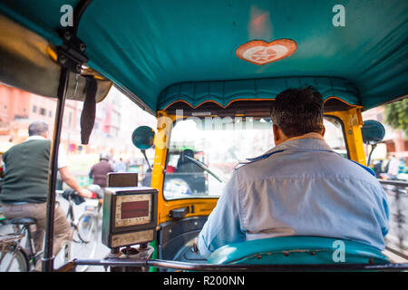 A rickshaw (also known as Tuc Tuc) driver is driving in the streets of Agra in India.