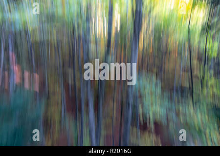 Abstract vertical stripes blurred background in green colors - Stock Photo