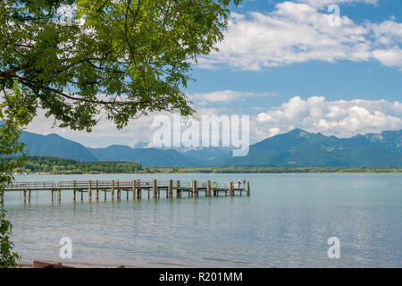 Lake Chiemsee: Jetty at the village Chieming with the Alps in background. Bavaria, Germany - Stock Photo