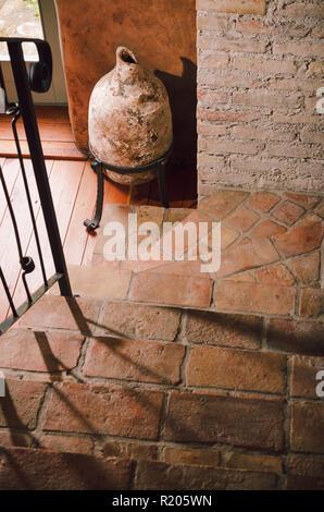 Big ancient roman amphora, jug and old stairways, indoor interior decoration - Stock Photo