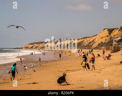 Newport Coast, California - October 8, 2018: A landscape view of the beach and large cliff at Crystal Cove in Newport Coast, California as seen on thi - Stock Photo