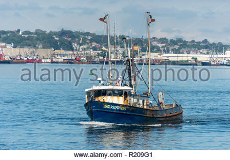 New Bedford, Massachusetts, USA - September 15, 2018: Commercial fishing vessel Silverfox, hailing port Cape May, New Jersey, under way with New Bedfo - Stock Photo