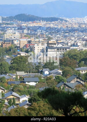 There are stunning views over Kyoto from the top of the hillside in the gardens at Jojakkoji Temple, Arashiyama, Kyoto - Stock Photo