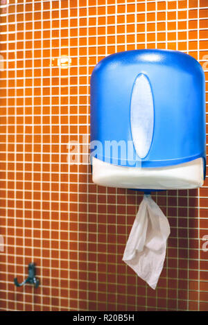 paper towels in the toilet. Paper hand towel dispenser. - Stock Photo
