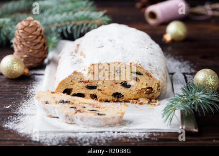 Christmas stollen cake. Traditional Dresdner christ pastry with marzipan and raisins. Close up. - Stock Photo