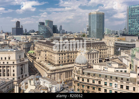 Rooftop skyline view of the Bank of England, Threadneedle Street, City of London financial district, EC2 with Angel Court and Moor House behind - Stock Photo
