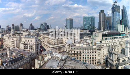 Rooftop skyline view of the Bank of England, Threadneedle Street, and City of London financial district, EC2 with iconic modern skyscrapers behind - Stock Photo