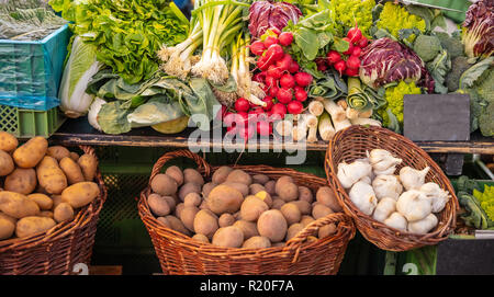 Colorful display of various vegetables in a local market in Berlin Germany, wallpaper - Stock Photo