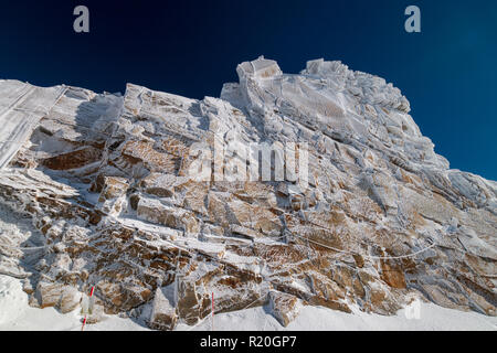 "So called ""frozen wall"" in front of a blue sky in Austrian ski region of Hintertux Glacier, Zillertal, Austria - Stock Photo"