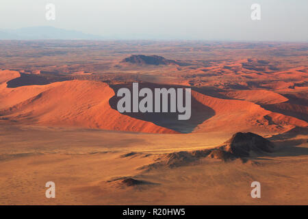 Aerial view of Namibia sand dunes seen from above, Sossusvlei, Namib Desert, Namib Naukluft National Park, Namibia Africa - Stock Photo