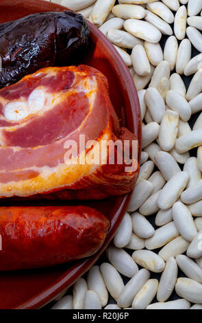 Ingredients to make an appetizing spoon dish. Delicious for autumn, winter and all year. Asturian fabada, typical dish of Asturias (Spain). Stew of be - Stock Photo
