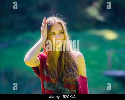 Pretty young teen woman looking away aside suspiciously suspicious serious - Stock Photo