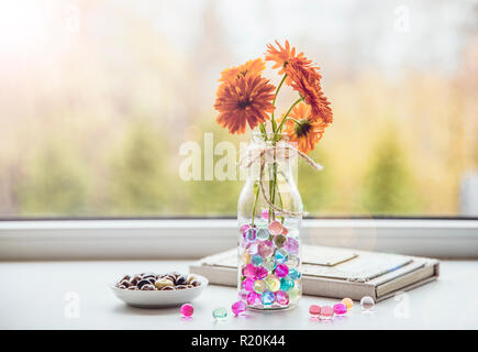 Water crystal gel or water beads is any gel which contains a large amount of water. Different color fun jelly water balls in flower vase on kitchen - Stock Photo