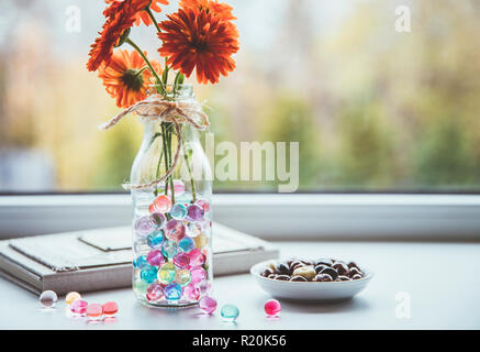 Water crystal gel or water beads is any gel which contains a large amount of water. Different color fun jelly water balls in flower vase in kitchen. - Stock Photo