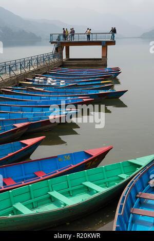 Colourful rowboats for hire, Phewa Lake, Pokhara, Nepal. - Stock Photo