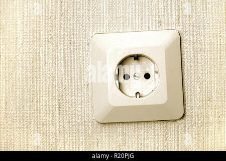 close-up of electric socket on wall - Stock Photo