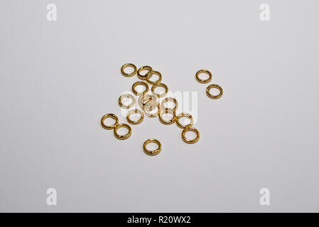 Hobby jewellery making gold plated rings. Isolated on white background - Stock Photo