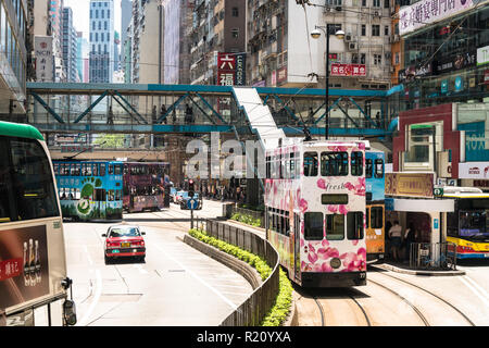 Hong Kong, China - May 16 2018: Tram and other traffic along Hennessy road in Causeway Bay, the famous shoppingl district in Hong Kong island, China - Stock Photo