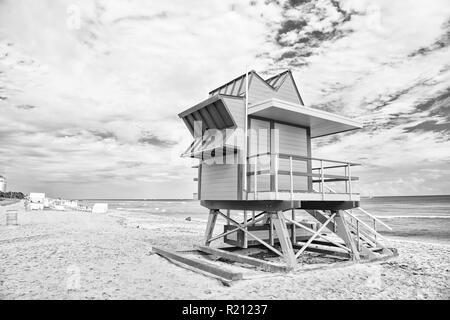 South Beach, Miami, Florida. lifeguard house in a colorful Art Deco style on cloudy blue sky at Miami South Beach and Atlantic Ocean in background, world famous travel location - Stock Photo