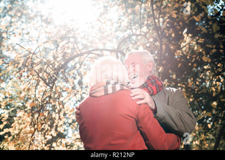 Old nice people having a date together - Stock Photo