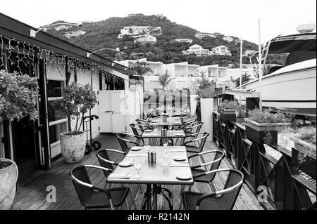 Terrace with tables, chairs and cutlery in philipsburg, sint maarten