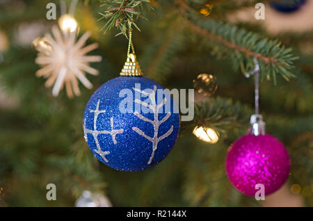 Decorations of christmas three, with mythological characters. Christmas-tree colored balls to decorate the Christmas tree.