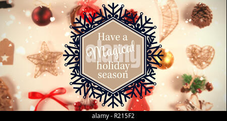 Composite image of snowflake 'have a magical holiday season' - Stock Photo