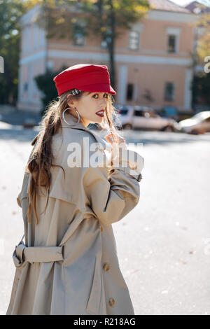 Stylish model with long dark hair wearing bright red beret - Stock Photo