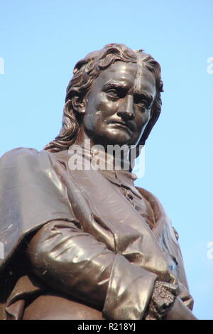 Statue of physicist and astronomer, Sir Isaac Newton in Grantham town centre, Lincolnshire, England, UK - Stock Photo