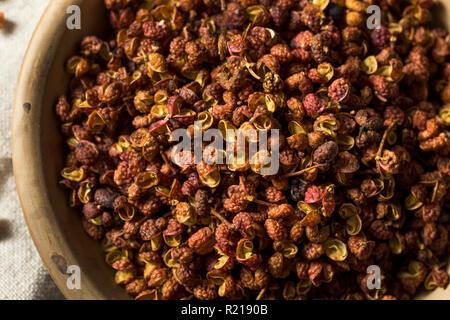Raw Organic Dry Szechuan Peppercorns in a Bowl - Stock Photo