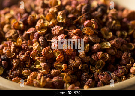 Raw Organic Dry Szechuan Peppercorns in a Bowl - Stock Photo
