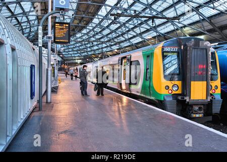 LIVERPOOL, UK - APRIL 20, 2013: People board London Midland train in Liverpool Lime Street Station, UK. It is part of Go-Ahead group, international tr - Stock Photo