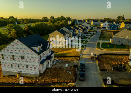 Aerial shot of American luxury upper middle class single family home real estate neighborhood in the East Coast under construction - Stock Photo